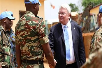 Hervé Ladsous greeting UN peacekeepers during a visit to the Central African Republic (CAR).