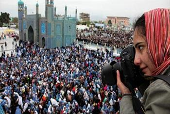 Photographer Farzana Wahidy covering a women's empowerment event in Mazar-i-Sharif, in Afghanistan's north.