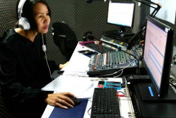 Cambodian Disabled People's Organisation staff member operates a radio program about history of Cambodia.