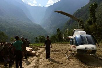 A Nepalese military helicopter delivers relief supplies to Ladhu village in Sindhulpalchok district.