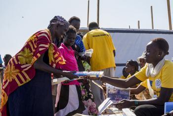 International Organization for Migration (IOM) staff member distributes soap in South Sudan.