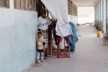 UNICEF says 3,600 schools have closed since fighting escalated in late March, while at least 270 are home to displaced families, like this one in Aden.