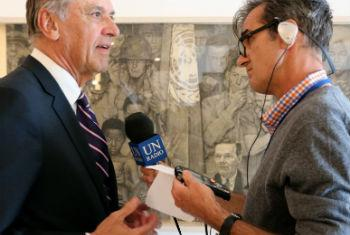 Jan Eliasson (left) speaking with UN Radio's Daniel Dickinson (right), about the Norman Rockwell's exhibition at UN Headquarters in New York.