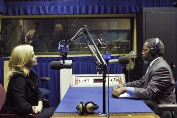Derrick S. Mbatha (right), United Nations Radio Producer, interviews Charlize Theron, United Nations Messenger of Peace.