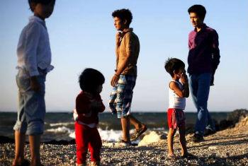 An extended family of Afghan asylum seekers, newly arrived on Greece's Lesvos Island. UNHCR File Photo/G. Moutafis