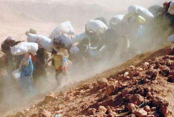Syrian refugees arrive across the border into Jordan. File