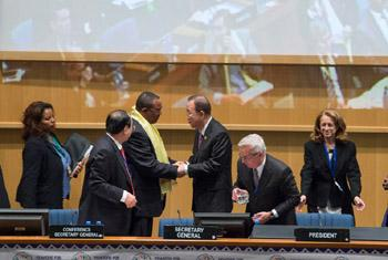 Secretary-General Ban Ki-moon (centre) greets Ethiopian Prime Minister Hailemariam Desalegn at the opening of the FFD3 conference in Addis Ababa.