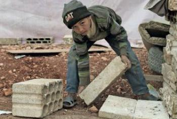 The children's agency says this nine-year old boy works in construction 12 hours a day.