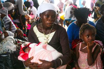 Mother holds her baby in Liberia.