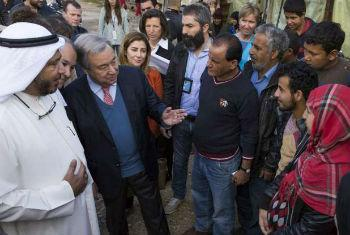 High Commissioner for Refugees António Guterres and Humanitarian Envoy for Kuwait Abdullah Al-Matouq (left) visit an Informal Settlement for Syrian refugees near Ghaziye, southern Lebanon. File