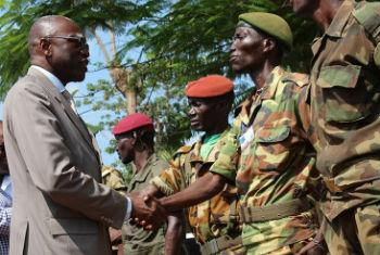 Special Representative and head of the UN peacekeeping mission, known as MINUSCA, Babacar Gaye (left) encourages ex-combatants to join the road to peace in the Central African Republic (CAR). File