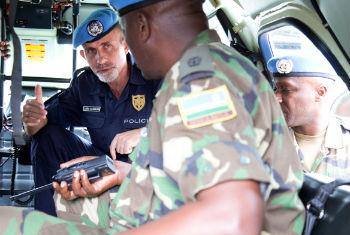 Luis Miguel Carrilho (facing camera), Police Commissioner of the MINUSCA, during a patrol through the streets of Bangui. UN File Photo/Nektarios Markogianni