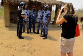 Silke von Brockhausen (right) assessing border security between Sierra Leone and Liberia with local security forces and UNIPSIL staff in March 2014.
