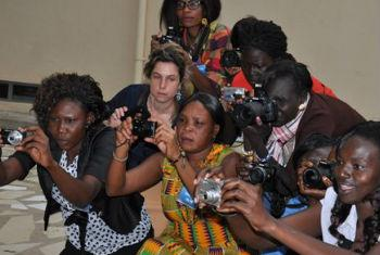 Female journalists participating on a workshop with international photojournalist Frederique Cifuentes.