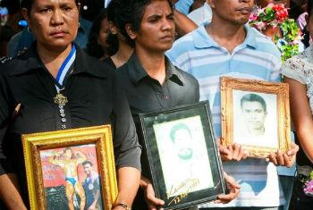 Photos of loved ones who died or who disappeared on 12 November 1991 when the Indonesian military opened fire on a peaceful demonstration. UN File Photo/Martine Perret