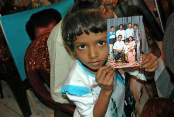 Relatives of missing persons from Sri Lanka's 26-year long civil war hold their pictures during a meeting in the capital Colombo.