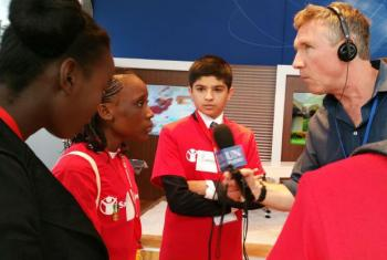 """Matt Wells interviews youngsters in the """"We the Peoples Hub""""."""