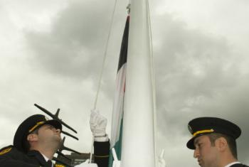 Members of the United Nations Honour Guard raise the flag of the State of Palestine for the first time at UN Headquarters in New York.