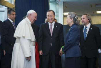 Secretary-General Ban Ki-moon and his wife, Yoo Soon Taek, with Pope Francis upon the pontiff's arrival at United Nations headquarters.