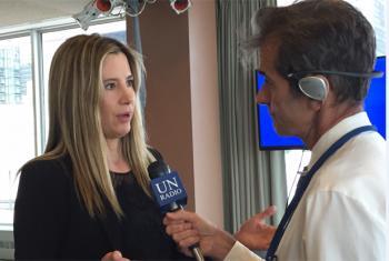 Mira Sorvino, actress and UNODC Goodwill Ambassador speaking to Daniel Dickinson.