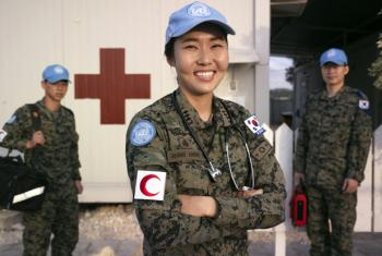 Eun-Bi Jeong, Nurse Officer, and two of her colleagues photographed next to clinic of the Korean Contingent Headquaters at UN Post 2-5 at the vicinity of Tyre, South Lebanon. UN File Photo/Pasqual Gorriz