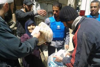 UNRWA distributes life-saving assistance to displaced civilians. File