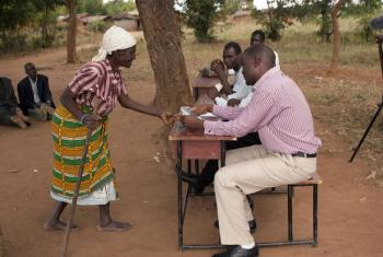 Zelifa Kampeza, 78, submits proof of her identity to administrators of a Social Cash Transfer programme in Malawi.