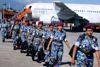 An all-woman Formed Police Unit from Bangladesh, serving with the UN Stabilization Mission in Haiti, arrives in Port-au-Prince to assist with post-earthquake reconstruction.