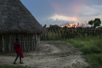 A girl plays as the sun sets in Nyal, South Sudan. The community has taken in those displaced.