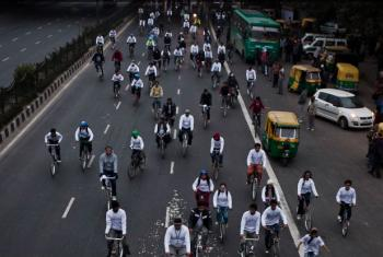 Event to promote a 'Clean India' in Delhi, India. WHO recommends cities to encourage cycling. File