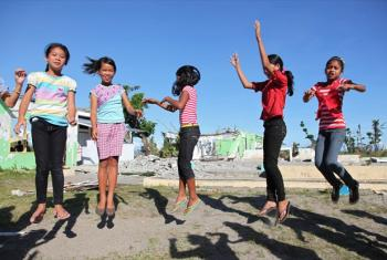 Girls play in the schoolyard at Santo Niño Elementary School in the town of Tanauan, Philippines.