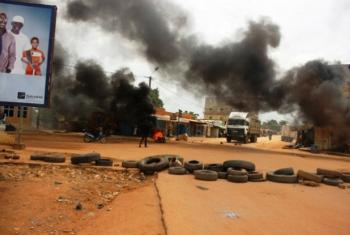 Protesters burn tires on the streets of Ouagadogou, Burkina Faso, following the government takeover by members of the presidential guard, earlier this year. File
