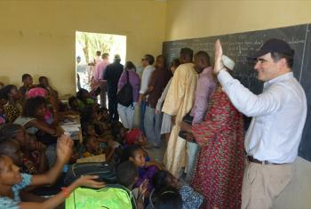 Head of Operations for the UN Office for the Coordination of Humanitarian Affairs (OCHA), John Ging (right), visits students in a classroom in Timbuktu, Mali.