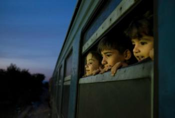 Children on a train at a reception centre for refugees and migrants in Gevgelija in the Former Yugoslav Republic of Macedonia.