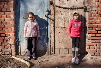 Girls are standing in a schoolyard in Sloviansk, Ukraine.
