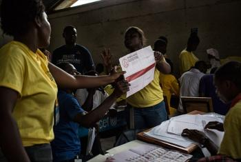 Officials in Haiti begin counting ballots at the end of polling on election day, 9 August 2015. File