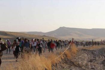 Syrians who fled across the Peshkhabour border into Kurdistan in northern Iraq walk towards a makeshift reception centre. File