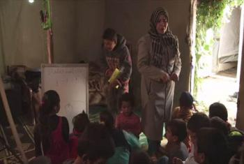 Teacher Fatima with students. UNIFEED (video capture)