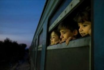 Children on a train at a reception centre for refugees and migrants.
