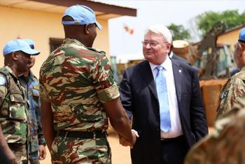 Hervé Ladsous, Under-Secretary-General for Peacekeeping Operations, greeting UN peacekeepers during a visit to the Central African Republic (CAR).