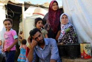 A Syrian refugee family in an informal tented settlement in Jdita town Bekaa Valley, Lebanon, where nearly 35 other families have lived for more than three years, after fleeing the war in Aleppo.