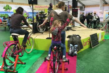 Power station at COP21 where participants don't just charge their cell phones, drink juices, or listen to music—they cycle for them.