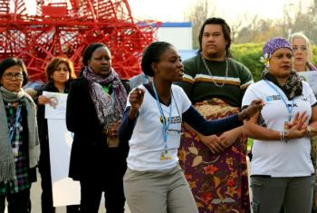 "Titi Akosa leads singing and dancing on ""Gender Day"" at COP21, highlighting the need for more women to be involved in negotiating the new climate change agreement. UN News Centre/Stephanie Coutrix"