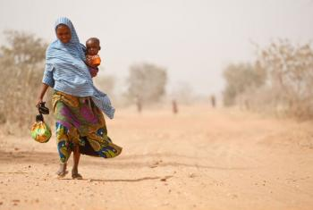 A woman and her son leave a UNICEF supported health centre in Maradi Region.
