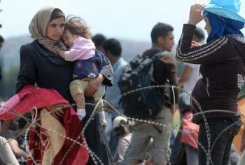 A Syrian woman pictured at the border of Greece and Macedonia.