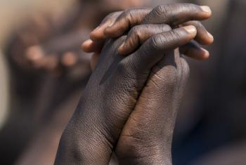 "Close-up of the children's hands linked together during the event ""From Peace in the Home to Peace in the Nation, Make Education Safe for Girls in South Sudan"", launched in November, at the POC Site 3 in Juba, South Sudan."