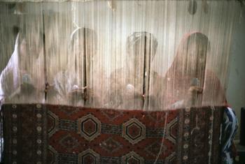 Girls learning to weave in Karachi, Pakistan.