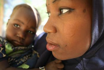 A young mother with her malnourished child at a screening centre in Gamdji. UN File Photo/WFP/Phil Behan