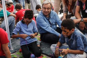 UN High Commissioner for refugees António Guterres sits among two young boys from Syria in a play area at the Moria Identification Centre, Lesvos, Greece. File
