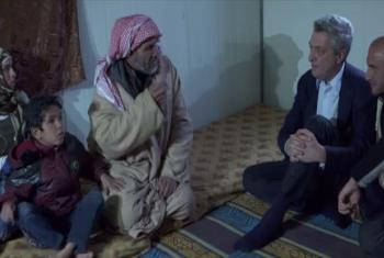 UN High Commissioner for Refugees Filippo Grandi meets with a family at Za'atari Refugee Camp, Jordan. UNIFEED (video capture)